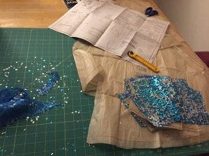 Cutting out a sequined bodice